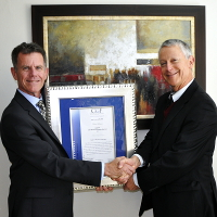 David Loxton (Right) accepts an Honorary Patronship from Terrance Booysen, CEO of CGF Research Institute