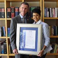 Ramani Naidoo accepts an Honorary Patronship from Terrance Booysen, CEO of CGF Research Institute